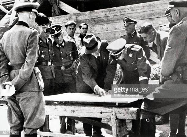 Reichsfuhrer-SS Heinrich Himmler in discussion with Chief Engineer Max Faust during Himmler's visit to the Monowitz-Buna plant at Auschwitz, Poland,...