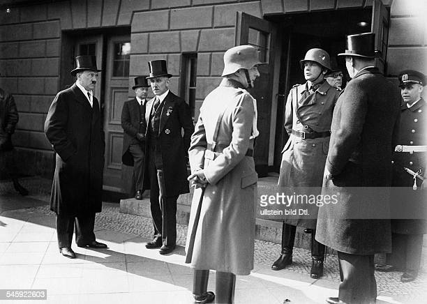 Reichskanzler Adolf Hitler ViceChancellor Franz von Papen and the Reichswehrminister Werner von Blomberg waiting for the President of the Reich Paul...