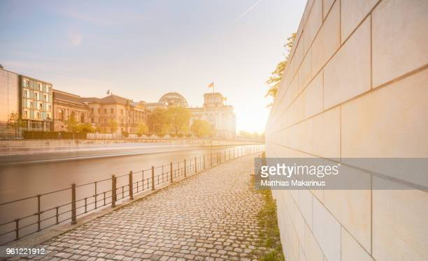reichstag berlin city summer skyline with spree river dynamic and sunlight - makarinus stock photos and pictures
