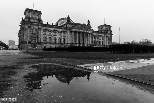 Reichstag building after ain with large puddle (German parliament building) - Berlin, Germany