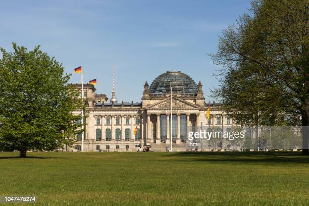 Reichstag building between trees (german parliament building) - Berlin, Germany