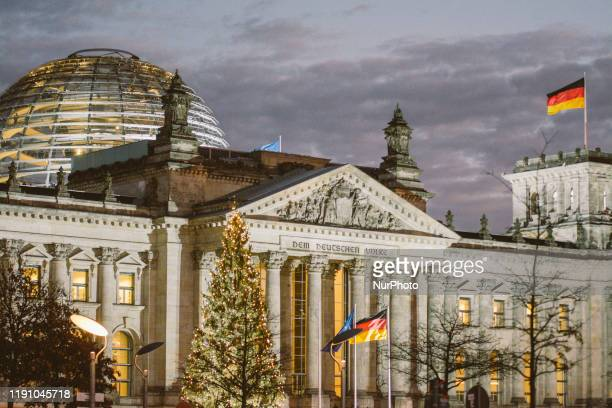 Reichstag Building is illuminated the night before New Year Eve Party at Brandenburg Gate in Berlin, Germany, on 30 December 2019.