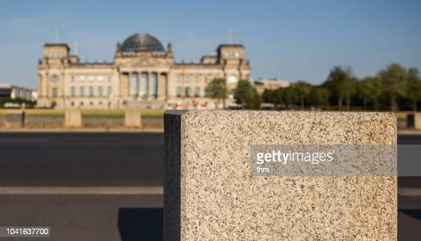 Reichstag building with a stone in the foreground(german parliament building) - Berlin, Germany