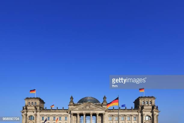 reichstag building with blue sky (german parliament building) - berlin, germany - reichstag stock-fotos und bilder