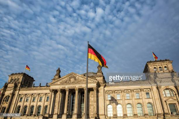 Reichstag building with german flag (german parliament building) - Berlin, Germany