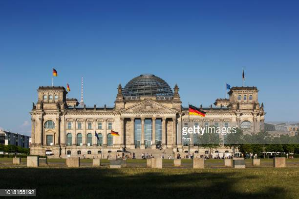 Reichstag building with german flags (german parliament building) - Berlin, Germany