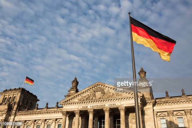 Reichstag building (Deutscher Bundestag) with german flags (Germany)