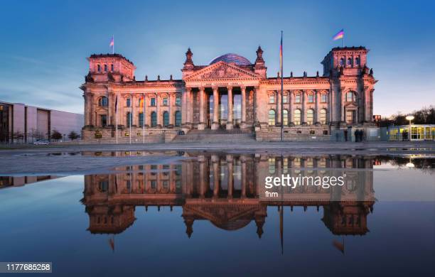 reichstag building with reflection in a puddle (german parliament building) - berlin, germany - central berlin stock pictures, royalty-free photos & images