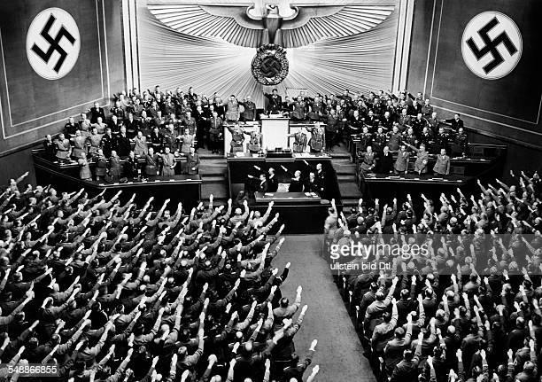 Reichstag meeting at the Krolloper in Berlin on the treasury bench a first row Adolf Hitler Rudolf Hess Joachim von Ribbentrop Erich Raeder Walther...