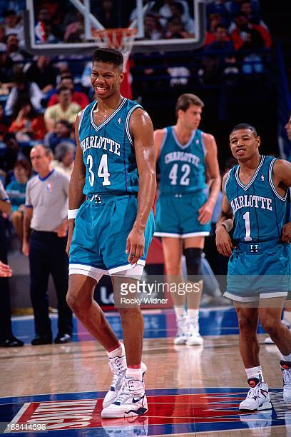 R Reid and Muggsy Bogues of the Charlotte Hornets walk against the Sacramento Kings during a game played on February 27 1991 at Arco Arena in...