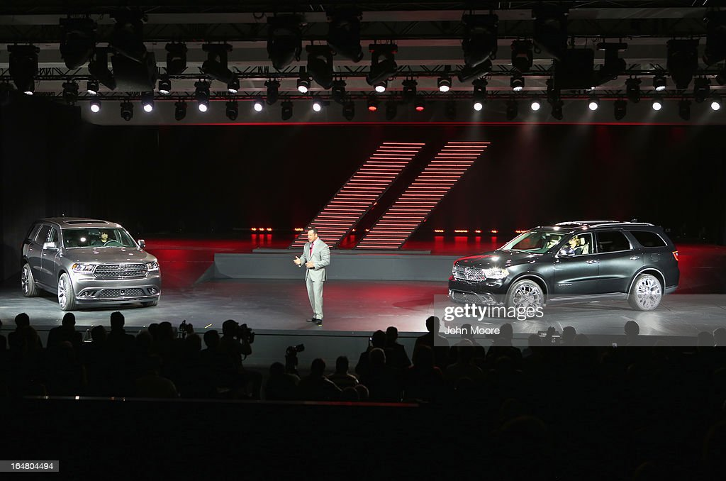 Reid Bigland, the CEO of Dodge and head of U.S. sales for Chrysler introduces the 2014 Dodge Durango RT (L), and the Dodge Durango Citadel to the media at the New York Auto show on March 28, 2013 in New York City. The 113th annual auto show is open to the public from March 29-April 7 and features more than 1,000 cars plus the latest automotive technology.