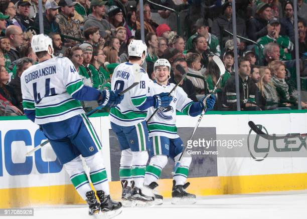 Reid Boucher Jake Virtanen Erik Gudbranson and the Vancouver Canucks celebrate a goal against the Dallas Stars at the American Airlines Center on...