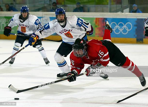 Reid Duke of Canada and Joel Kiviranta of Finland battle for the puck in the semi final match between Canada and Finland in the Ice Hockey at the...