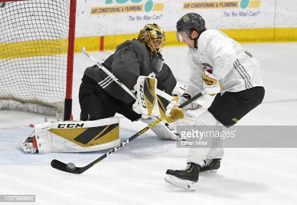Reid Duke of the Vegas Golden Knights takes a shot against teammate Marc-Andre Fleury during a training camp practice at City National Arena on July...