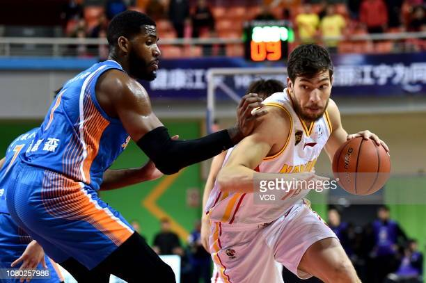 Reid Duncan Overbeck of Nanjing Monkey King drives the ball against Jason Thompson of Sichuan Blue Whales during the 2018/2019 Chinese Basketball...