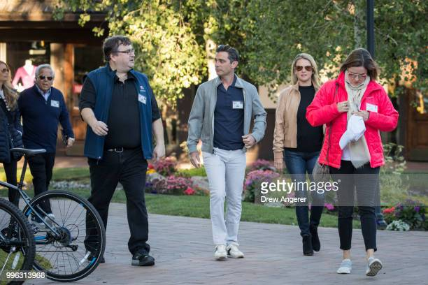 Reid Hoffman cofounder of LinkedIn and partner at venture capital firm Greylock Partners and Dan Rose vice president partnerships at Facebook arrive...