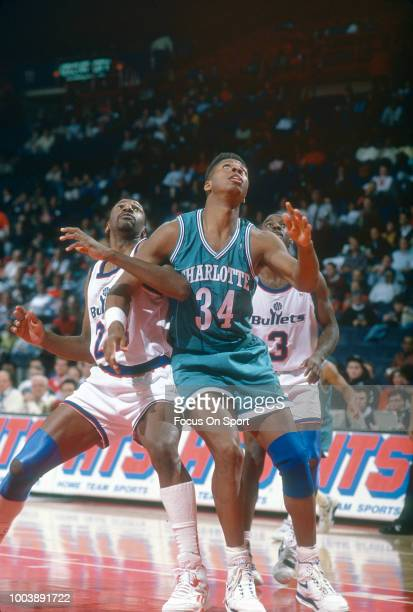 R Reid of the Charlotte Hornets battles for position with Charles Jones of the Washington Bullets during an NBA basketball game circa 1991 at the...
