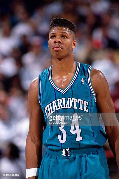 R Reid of the Charlotte Hornets looks on against the Sacramento Kings during a game played on February 27 1991 at Arco Arena in Sacramento California...