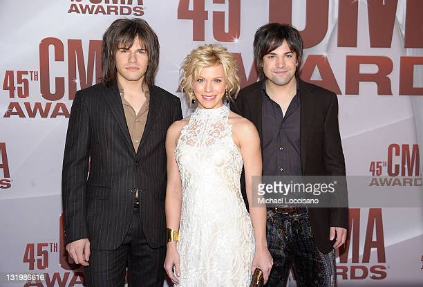 Reid Perry Kimberly Perry and Neil Perry of The Band Perry attend the 45th annual CMA Awards at the Bridgestone Arena on November 9 2011 in Nashville...