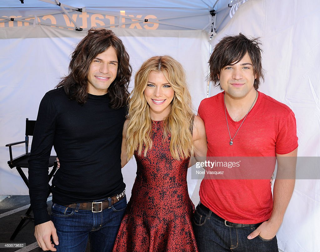 Reid Perry, Kimberly Perry and Neil Perry of The Perry Band visit 'Extra' at Universal Studios Hollywood on August 13, 2014 in Universal City, California.