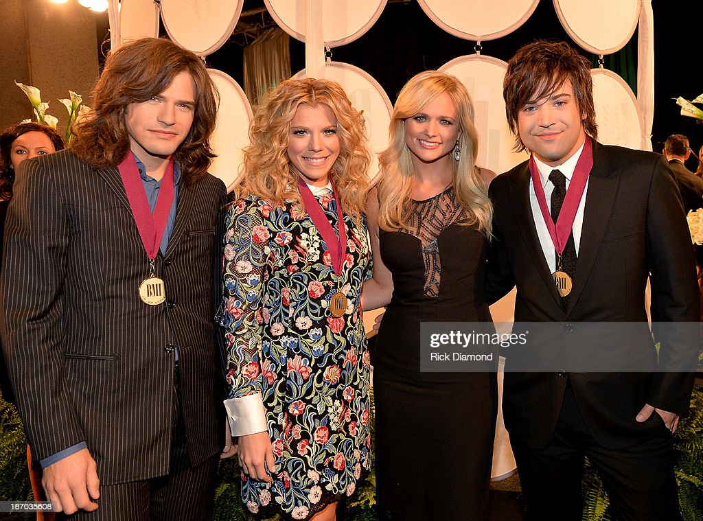 Reid Perry, Kimberly Perry, Miranda Lambert, and Neil Perry attend the 61st annual BMI Country awards on November 5, 2013 in Nashville, Tennessee.