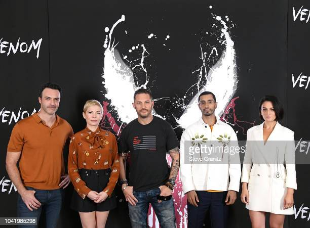 """Reid Scott, Michelle Williams, Tom Hardy, Riz Ahmed, and Jenny Slate poses at the Photo Call For Columbia Pictures' """"Venom"""" at Four Seasons Hotel Los..."""