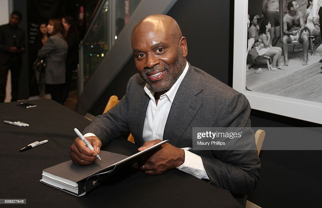 L.A. Reid signs his book at Icons of the Music Industry: L.A. Reid at The GRAMMY Museum on February 9, 2016 in Los Angeles, California.