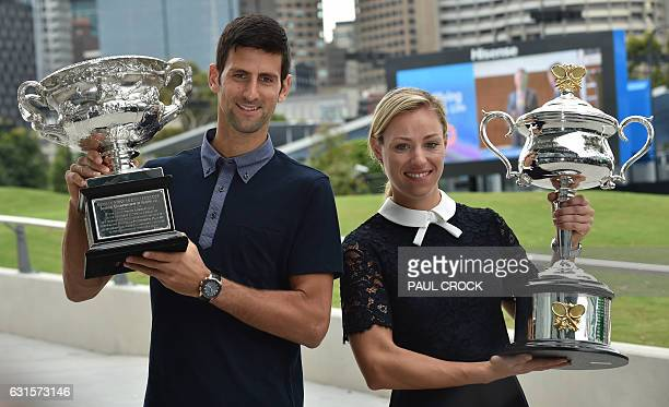 Reigning Australian Open Champions Angelique Kerber of Germany and Novak Djokovic of Serbia carry the trophies ahead of the Australian Open tennis...