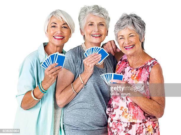 reigning card champions? you bet - bridge card game stock-fotos und bilder
