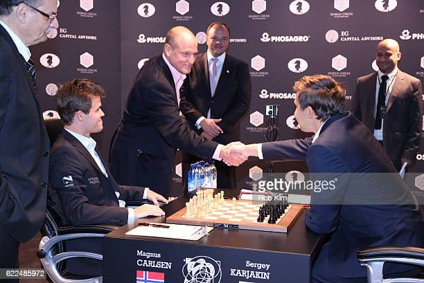 Reigning Chess Champion Magnus Carlsen and Chess grandmaster Sergey Karjakin are greeted by Actor Woody Harrelson during 2016 World Chess...