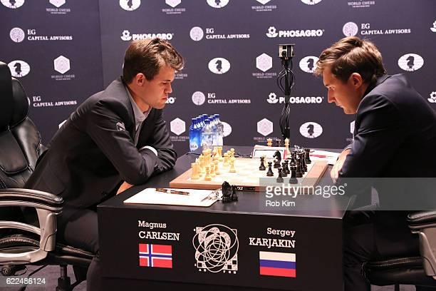 Reigning Chess Champion Magnus Carlsen and Chess grandmaster Sergey Karjakin start the game during 2016 World Chess Championship at Fulton Market...
