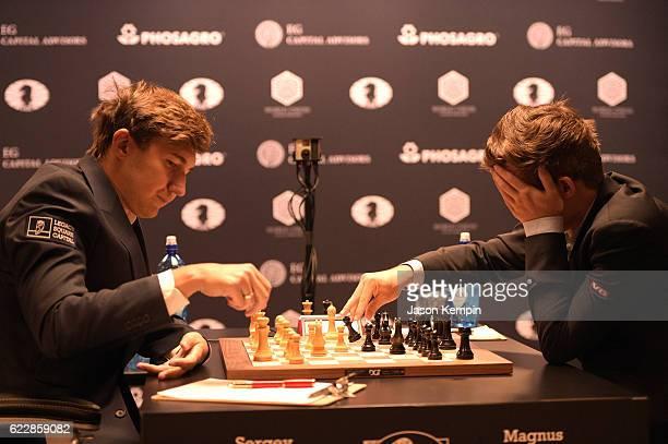 Reigning Chess Champion Magnus Carlsen and Chess grandmaster Sergey Karjakin during the game at 2016 World Chess Championship at Fulton Market...