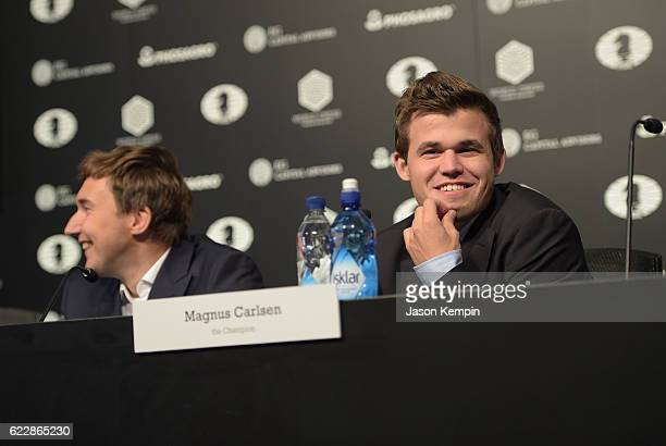 Reigning Chess Champion Magnus Carlsen and Chess grandmaster Sergey Karjakin speaks during the press conference after a draw at 2016 World Chess...