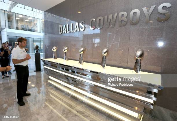 Reigning Indianapolis 500 Champion Will Power looks at the Dallas Cowboys Superbowl trophies on display during a tour of the headquarters and...