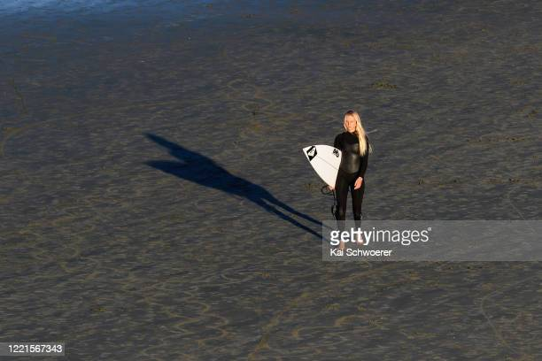 Reigning New Zealand Surfing champion Ava Henderson looks on during a portrait session at Sumner Beach on April 28 2020 in Christchurch New Zealand...