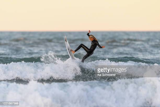 Reigning New Zealand Surfing champion Ava Henderson surfs following a portrait session at Sumner Beach on April 28 2020 in Christchurch New Zealand...