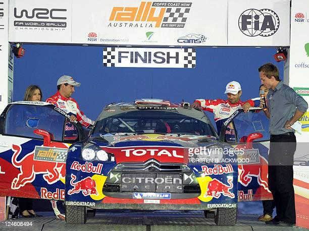Reigning seven-time world champion Sebastien Loeb of France and Citroen DS3 co-driver Daniel Elena of Monaco react at the finish of Rally Australia,...