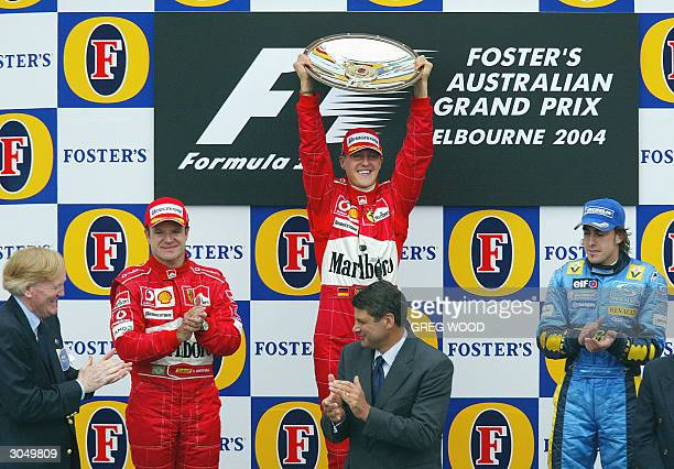 Reigning sixtime World Champion Michael Schumacher of Germany holds up the trophy on the podium after winning the Australian Grand Prix in Melbourne...
