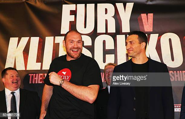 Reigning WBO WBA and IBO heavyweight champion Tyson Fury dances alongside Wladimir Klitschko during Tyson Fury and Wladimir Klitschko head to head...