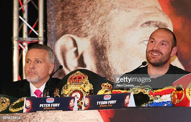 Reigning WBO WBA and IBO heavyweight champion Tyson Fury looks on alongside trainer and uncle Peter Fury during Tyson Fury and Wladimir Klitschko...