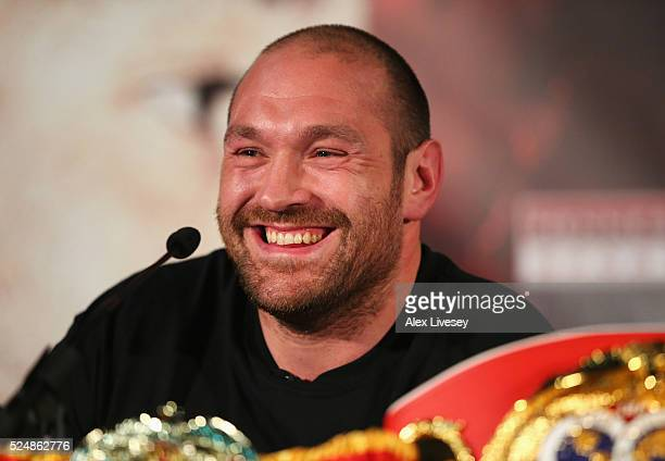Reigning WBO WBA and IBO heavyweight champion Tyson Fury smiles during Tyson Fury and Wladimir Klitschko head to head press conference at Manchester...