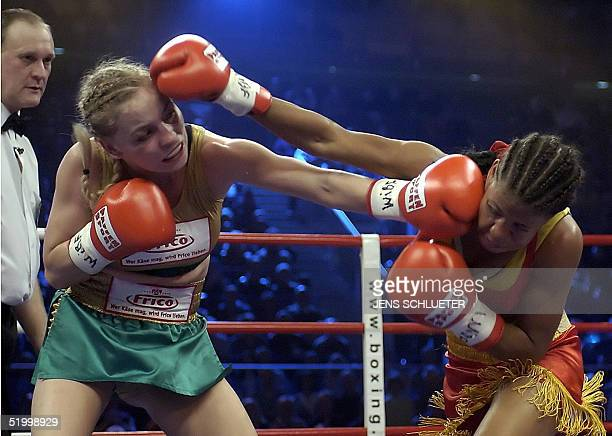 Reigning WIBF flyweight champion Regina Halmich from Germany slugs it out with Marylin Hernandez from the Dominican Republic as she defends her title...