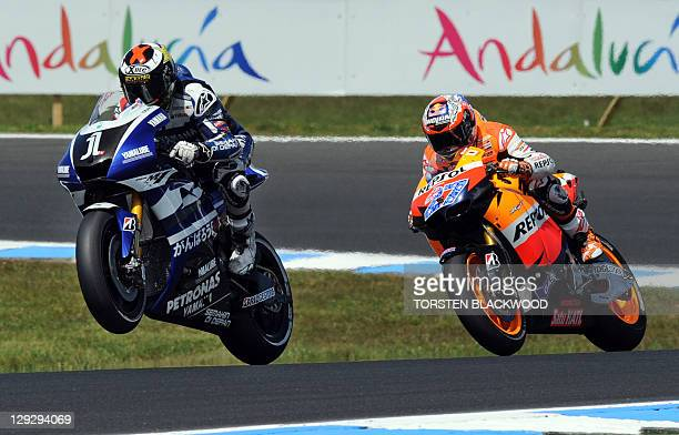 Reigning world champion Jorge Lorenzo of Spain powers in front of Honda's Casey Stoner of Australia moments before crashing his Yamaha during the...