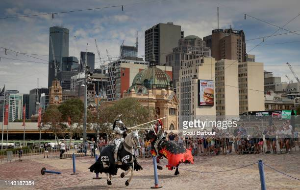 Reigning world champion Phillip Leitch and Australian team mate Cliff Marisma of Australia perform a medieval solid lance joust in modern day...