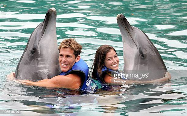 Reigning world surfing champion Andy Irons of the United States of America and girlfriend Lyndie Dupuis swins with dolphins at Sea World on March 17...