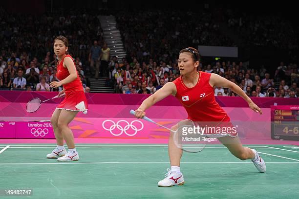 Reika Kakiiwa and Mizuki Fujii return a shot against of Shinta Mulia Sari and Lei Yao of Singapore during their Women's Singles Badminton on Day 2 of...