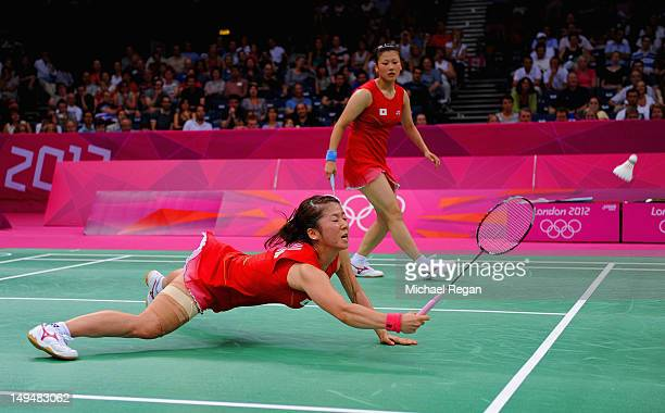 Reika Kakiiwa and Mizuki Fujii return a shot against of Shinta Mulia Sari and Lei Yao of Singapore during their Women's Doubles Badminton on Day 2 of...