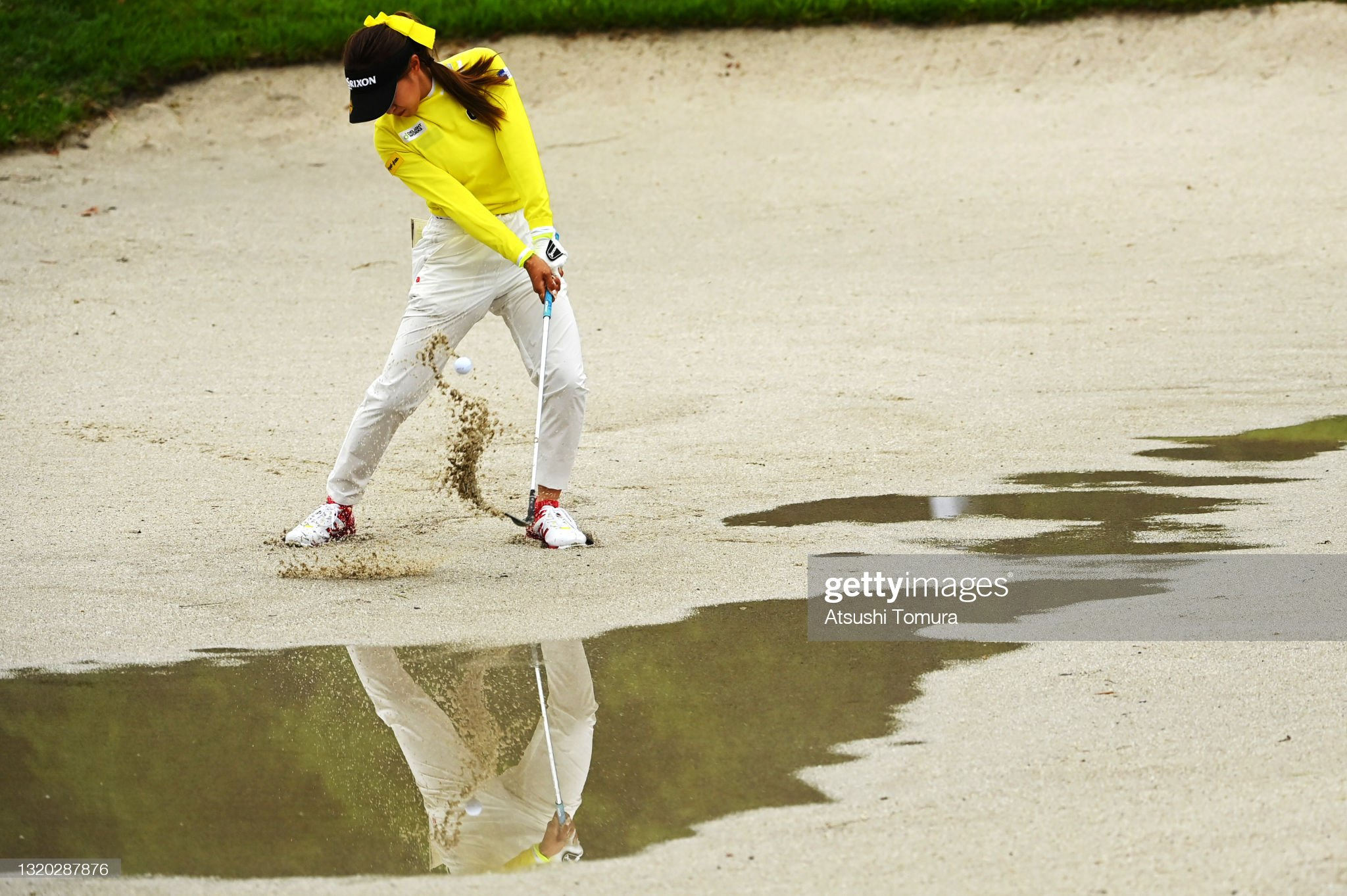 https://media.gettyimages.com/photos/reika-usui-of-japan-hits-out-from-a-bunker-on-the-2nd-hole-during-the-picture-id1320287876?s=2048x2048