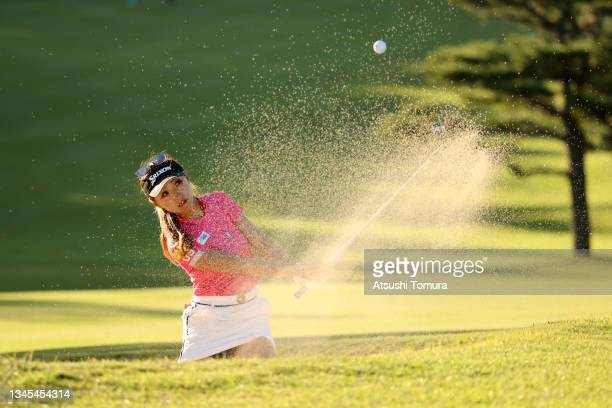 Reika Usui of Japan hits out from a bunker on the 5th hole during the first round of the Stanley Ladies at Tomei Country Club on October 8, 2021 in...