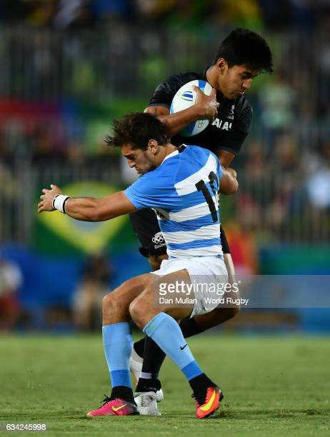 Reiko Ioane of New Zeland is tackled by Bautista Ezcurra of Argentina during the Men's Rugby Sevens placing match between New Zealand and Argentina...